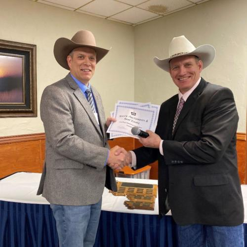 J.K. Kinsey with Kinsey Auctioneers and Real Estate accepts the Marketing Competition awards from MAA President Kevin Hill.